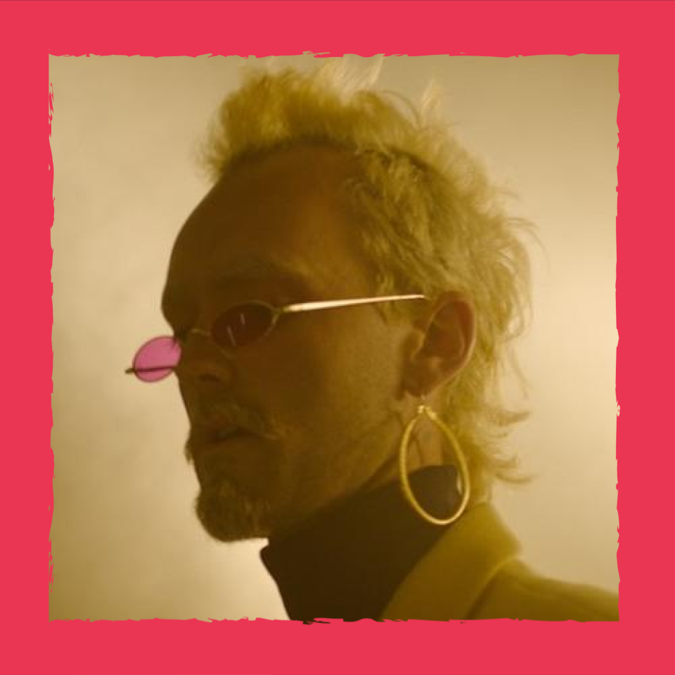 Portrait of Thor Rixon with Blonde hair, thin sunglasses, and hoop earings.
