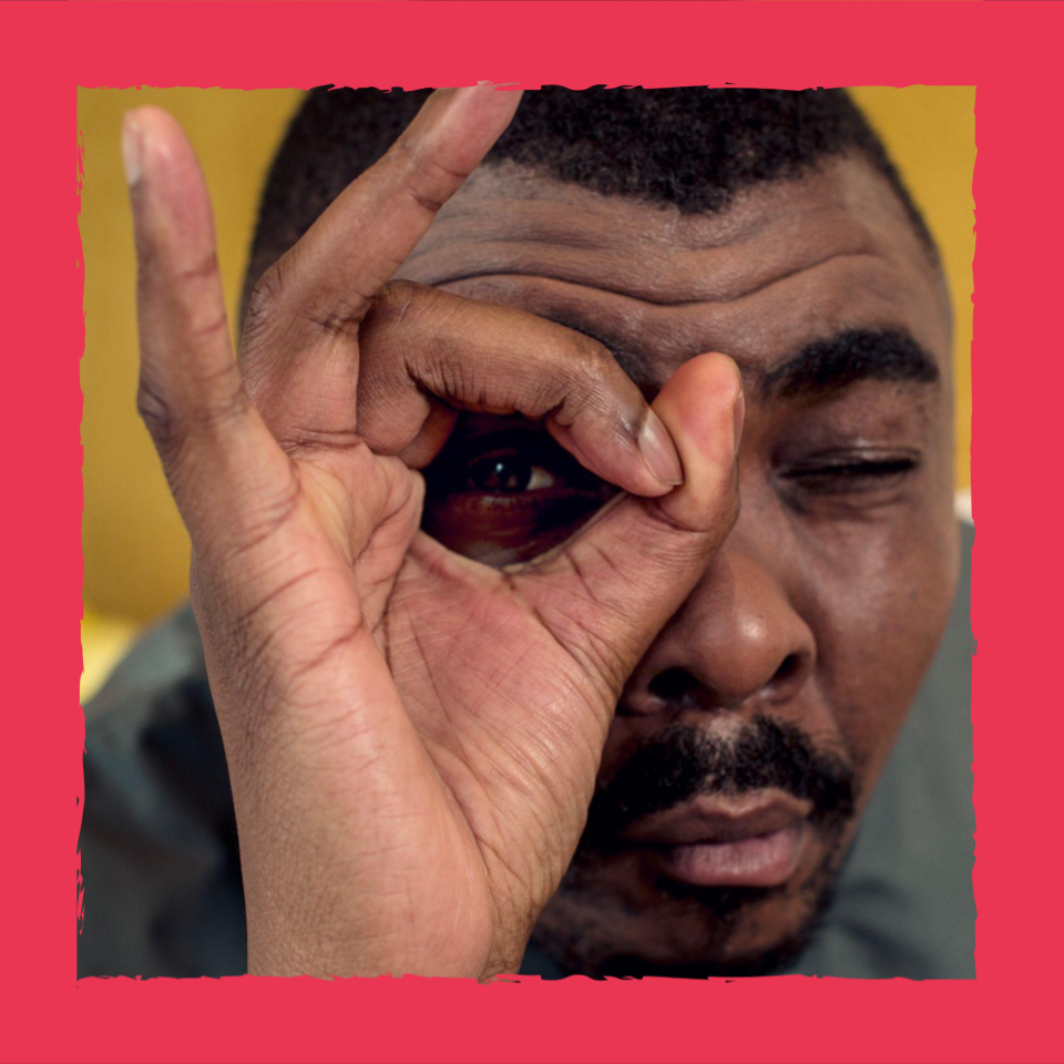Close up of Loyiso Gola with his forefinger and thumb in a circle around his eye